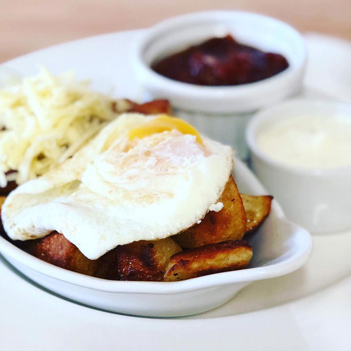 Patatas bravas and poached egg brunch